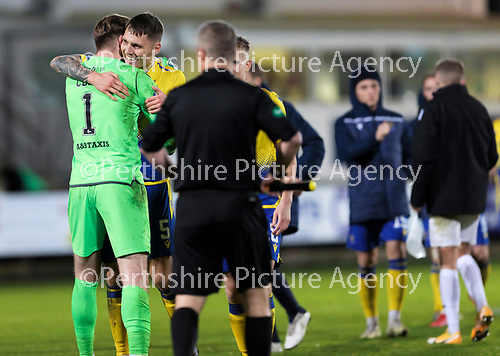 Dunfermline v St Johnstone…15.12.20   East End Park      BetFred Cup<br />Jason Kerr hugs Zander Clark at full time<br />Picture by Graeme Hart.<br />Copyright Perthshire Picture Agency<br />Tel: 01738 623350  Mobile: 07990 594431