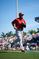 Boston Red Sox right fielder Bryce Brentz (64) jogs to the dugout during a Spring Training game against the Pittsburgh Pirates on March 9, 2016 at McKechnie Field in Bradenton, Florida.  Boston defeated Pittsburgh 6-2.  (Mike Janes/Four Seam Images)