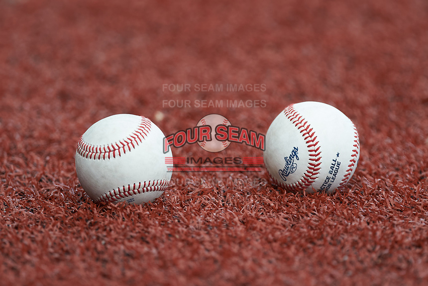 A pair of baseballs sit on the turf prior to game three of the South Atlantic Border Battle at Truist Point on September 26, 2020 in High Pont, NC. (Brian Westerholt/Four Seam Images)