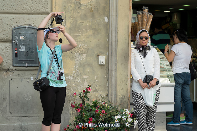 Tourist crowds on guided tours outside the Duomo cathedral Florence, Italy.