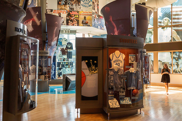 May 8, 2015. Chapel Hill, North Carolina.<br />  Allie Jorgensen, who will graduate from UNC on the following day, takes a tour of The Carolina Basketball Museum. The Carolina Basketball Museum, located near the Dean Dome, holds a wide variety of UNC basketball memorabilia and historical videos. <br />  Outsiders tend to lump Chapel Hill with nearby Durham, but the more sensible pairing is with Carrboro, the adjacent town that was once a mere offshoot known as West End. Even today the transition from Chapel Hill, anchored by North Carolina''s flagship public university, into downtown Carrboro is virtually seamless.