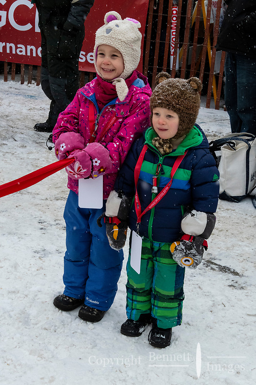 Holding the ribbon getting ready to start festivities at 4th Avenue and D street in downtown Anchorage, Alaska on Saturday March 7th during the 2020 Iditarod race. Photo copyright by Cathy Hart Photography.com