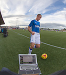 Kenny Miller interrupting my picture captioning and transmission as he shepherds the ball