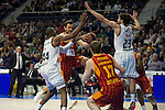 Real Madrid´s Marcus Slaughter and Sergio Llull and Galatasaray´s Arslan and Pocius during 2014-15 Euroleague Basketball match between Real Madrid and Galatasaray at Palacio de los Deportes stadium in Madrid, Spain. January 08, 2015. (ALTERPHOTOS/Luis Fernandez)