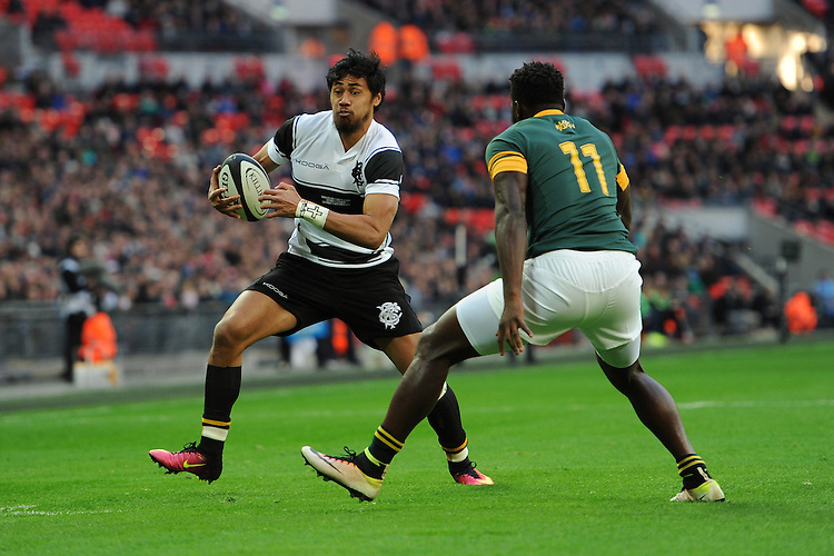 Melani Nanai (Blues) of Barbarians goes round Jamba Ulengo of South Africa to score the opening try during the Killik Cup match between Barbarians and South Africa at Wembley Stadium on Saturday 5th November 2016 (Photo by Rob Munro)