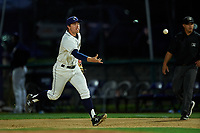 Tri-City Dust Devils first baseman Luke Becker (10) flips the ball to the pitcher covering first base during a Northwest League game against the Vancouver Canadians at Gesa Stadium on August 21, 2019 in Pasco, Washington. Vancouver defeated Tri-City 1-0. (Zachary Lucy/Four Seam Images)