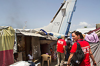"A mass casuality incident drill is held in Jean Marie Vincent 2, a tent city, in Haiti for EMT students by volunteer EMTs from the United States from EMPACT Northwest.  The students first reviewed their lessons at Boujet Park where they have studied and interpreted for medical personal for almost two years since the earthquake in 2009.  Volunteers instructors and EMT's from EMPACT applied moulage (make up) for the ""victims"" on site. Present were the United Nations Police who have been stationed there for two weeks. (photo copyright Karen Ducey)"