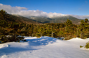 Scenic view of the northern Presidential Range from Low's Bald Spot in the White Mountains of New Hampshire during the winter months. This view point is located just off the Appalachian Trail (Madison Gulf Trail).