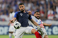 Lyon, France - Saturday June 09, 2018: Olivier Giroud, Cameron Carter-Vickers during an international friendly match between the men's national teams of the United States (USA) and France (FRA) at Groupama Stadium.