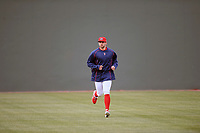 Starting pitcher Alex Scherff (18) of the Greenville Drive runs in the outfield before a game against the Rome Braves on Saturday, April 20, 2019, at Fluor Field at the West End in Greenville, South Carolina. Rome won, 5-4. (Tom Priddy/Four Seam Images)