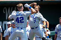 Duke Blue Devils third baseman Erikson Nichols (42) celebrates a home run with Chris Dutra (7) during the game against the Wright State Raiders in NCAA Regional play on Robert M. Lindsay Field at Lindsey Nelson Stadium on June 5, 2021, in Knoxville, Tennessee. (Danny Parker/Four Seam Images)