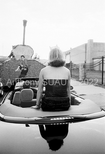 Memphis, Tennessee<br /> USA<br /> August 11, 2002<br /> <br /> Miss Memphis waits atop her car to be paraded on Beale street to mark the the 25 year anniversary of Elvis Presley's death.