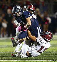 Ethan Fender (5) of Springdale Har-ber gets tackled by Ricardo Gonzalez (17) of Springdale on Friday, Oct. 8, 2021, during the first half of play at Wildcat Stadium in Springdale. Visit nwaonline.com/211009Daily/ for today's photo gallery.<br /> (Special to the NWA Democrat-Gazette/David Beach)