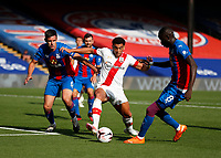 12th September 2020; Selhurst Park, London, England; English Premier League Football, Crystal Palace versus Southampton; Che Adams of Southampton is challenged by Scott Dann and Cheikhou Kouyate of Crystal Palace