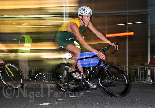 28 JUN 2012 - LONDON, GBR - Peter Kerr of Australia on the bike during the elite men's 2012 Canary Wharf Triathlon final in Canary Wharf, London, Great Britain (PHOTO (C) 2012 NIGEL FARROW)