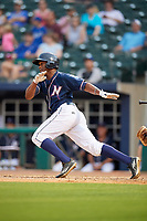 Northwest Arkansas Naturals left fielder Elier Hernandez (21) follows through on a swing during a game against the Midland RockHounds on May 27, 2017 at Arvest Ballpark in Springdale, Arkansas.  NW Arkansas defeated Midland 3-2.  (Mike Janes/Four Seam Images)