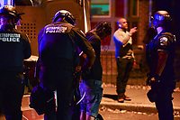 Washington, DC - June 1, 2020: D.C. Metropolitan Police arrest a man who ran towards them as protesters gather at 15th & Swann St. NW, Washington, DC  June 1, 2020, in the wake of the death of George Floyd by a Minnesota police officer.  (Photo by Don Baxter/Media Images International)