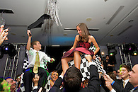 Brother and sister being lifted in chairs during <br /> the hora dance at a New York City B'Nai Mitzvah