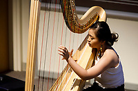 Harpist Jessica Sudarta performs during the Composition Forum at the 11th USA International Harp Competition at Indiana University in Bloomington, Indiana on Monday, July 8, 2019. (Photo by James Brosher)