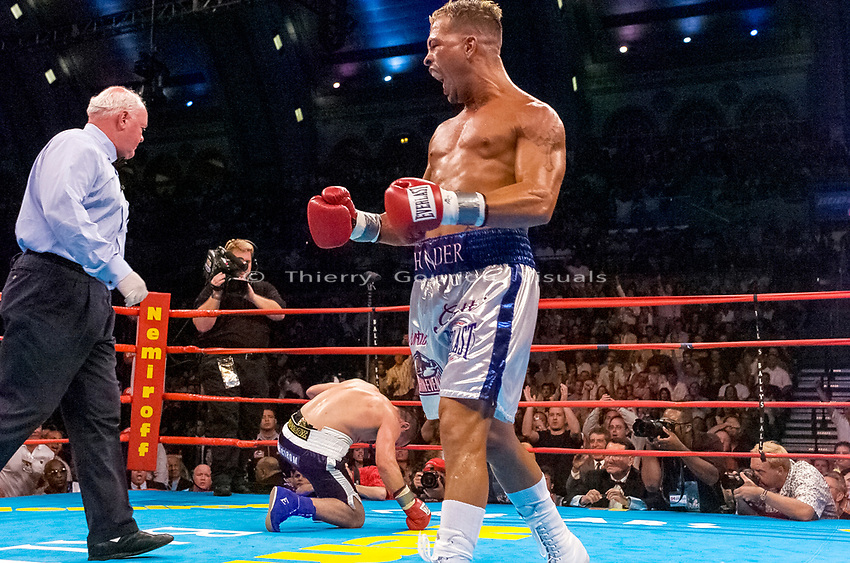 Arturo Gatti (right) sends his opponent Leonard Dorin to the canvas during the WBC Super Lightweight Championship at the Boardwalk Hall in Atlantic City, New Jersey on July 24, 2004. Gatti 's left body shot to the body ended the fight in the 2nd Round and sealed his victory. Photo by Thierry Gourjon.