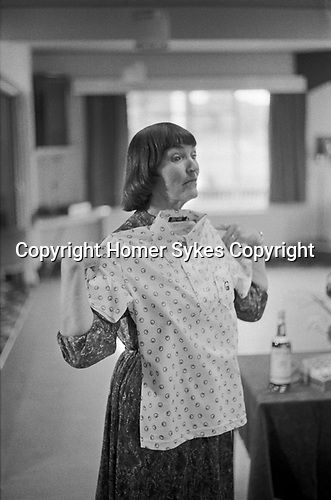 Didsbury Golf Club, near Manchester 1981. Middle England, Middle Class, Middle Age 1980s UK. After lunch there is a raffle , a woman blouse is being shown off.