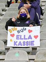 """Young RSCA players with a sign saying """"Big Hug Ella Kassie"""" pictured before a female soccer game between RSC Anderlecht Dames and Oud Heverlee Leuven on the seventh matchday of play off 1 of the 2020 - 2021 season of Belgian Womens Super League , saturday 15 th of May 2021  in Brussels , Belgium . PHOTO SPORTPIX.BE   SPP   SEVIL OKTEM"""