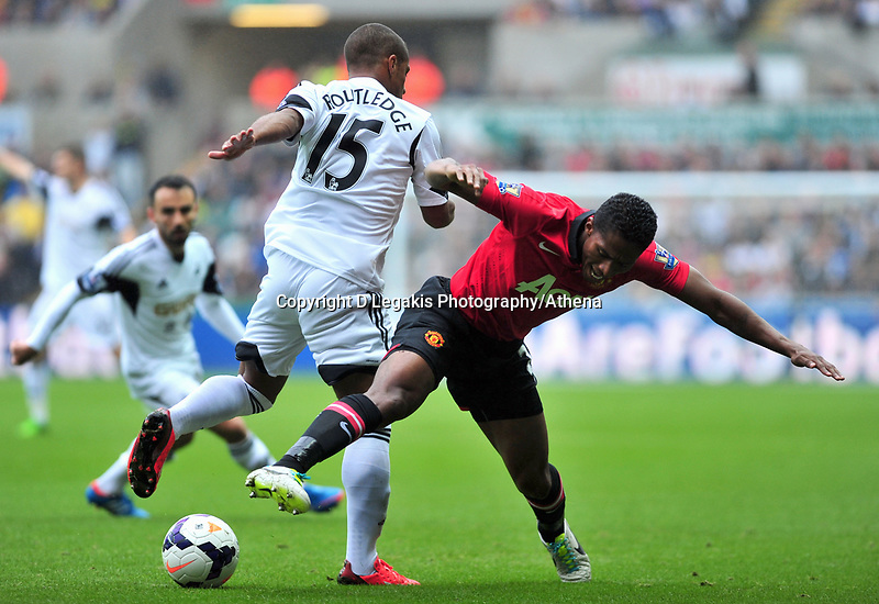 Wayne Routledge challenging Manchester United's Antonio Valencia.<br /> Saturday 17 August 2013<br /> Pictured: <br /> Re: Barclays Premier League Swansea City v Manchester United at the Liberty Stadium, Swansea, Wales