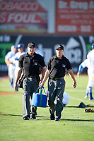 Umpires Colin Baron and Jake Bruner walk onto the field prior to the game between the Ogden Raptors and the Orem Owlz in Pioneer League action at Lindquist Field on June 27, 2017 in Ogden, Utah. Ogden defeated Orem 14-5. (Stephen Smith/Four Seam Images)