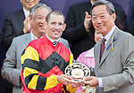 Jockey Hugh Bowman receives a trophy after his horse Lucky Bubbles won the Chairman's Sprint Prize (1200m) on 07 May 2017, at the Sha Tin Racecourse  in Hong Kong, China. Photo by Chris Wong / Power Sport Images