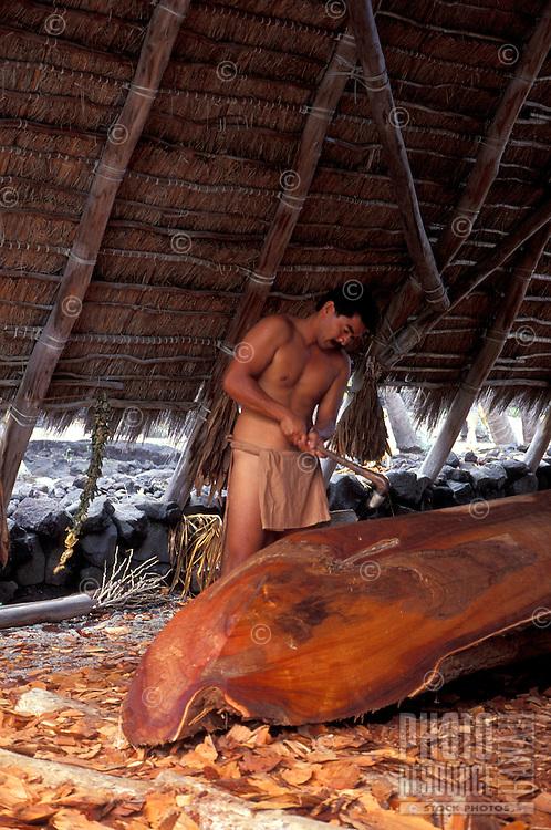 One man working on crafting a boat, city of refuge (Puu Honua o Honaunau)