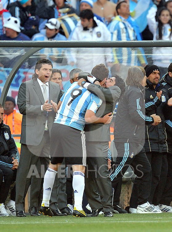 Diago Maradona kisses Gonzalo HIGUAIN during the 2010 World Cup Soccer match between Argentina vs Korea Republic played at Soccer City in Johannesburg, South Africa on 17 June 2010.