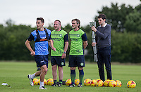 Manager Gareth Ainsworth & Assistant Manager Richard Dobson look on as Matt Bloomfield is in action & Media Manager Matt Cecil films during the Wycombe Wanderers 2016/17 Pre Season Training Session at Wycombe Training Ground, High Wycombe, England on 1 July 2016. Photo by Andy Rowland / PRiME Media Images.