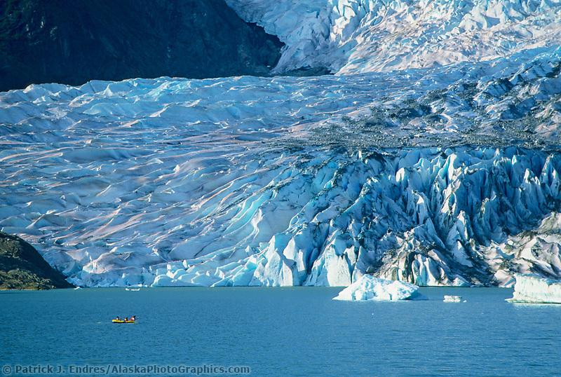 Rafters paddle in the lake at the Mendenhall Glacier terminus, Juneau, Alaska.