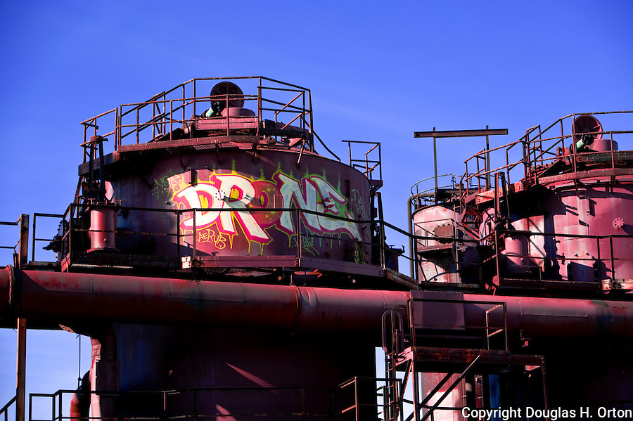 Rusting equipment at historic, former gas plant that served Seattle, WA, now incorporated into Gas Works Park, a Seattle city park, is decorated with Graffiti.