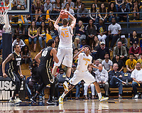 California's David Kravish rebounds the ball during final seconds of overtime the game against Colorado at Haas Pavilion in Berkeley, California on March 8th, 2014. California defeated Colorado 66 - 65