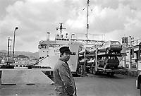 - Sicily, boarding of Panda cars builds in the FIAT plant of Termini Imerese on a ferry in Messina (April 1980)....- Sicilia, imbarco di auto Panda costruite nello stabilimento FIAT di Termini Imerese su un traghetto a Messina (aprile 1980)