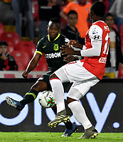 BOGOTA-COLOMBIA, 08-03-2020: Dixon Renteria de Independiente Santa Fe y Baldomero Perlaza de Atletico Nacional disputan el balon durante partido entre Independiente Santa Fe y Atletico Nacional de la fecha 8 por la Liga BetPlay DIMAYOR 2020 jugado en el estadio Nemesio Camacho El Campín de la ciudad de Bogota. / Dixon Renteria of Independiente Santa Fe and Baldomero Perlaza of Atletico Nacional vie for the ball during a match of the 8th date between Independiente Santa Fe and Atletico Nacional, for the BetPlay DIMAYOR I Leguaje 2020 at the Nemesio Camacho El Campin Stadium in Bogota city. / Photo: VizzorImage / Luis Ramirez / Staff.