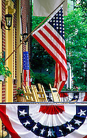 USA flag displayed on  porch with bunting