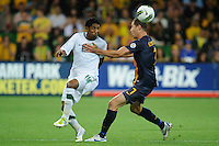 Salem AL DAWSARI (19) of Saudi Arabia and Brett EMERTON (7) of Australia compete for the ball during the FIFA 2014 World Cup Group D Asian Qualifier match between Australia and Saudi Arabia at AAMI Park in Melbourne, Australia...This image is not for sale on this web site. Please contact Southcreek Global Media for licensing:.Toll Free: 1.800.934.5030.Canada: 701 Rossland Rd. East, Suite 315, Whitby, Ontario, Canada, L1N 9K3.USA: 10792 Baron Dr, Parma OH, USA 44130.Web: http://southcreekglobal.net/ and http://southcreekglobal.com/
