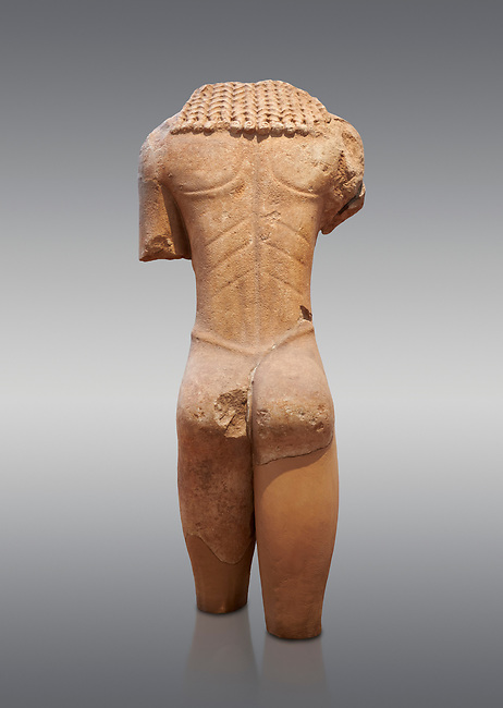 Archaic ancient Greek marble torso of a kouros statue, from Temple of Poseidon, Sounion, circa 600 BC, Athens National Archaeological Museum. Cat no 3645.   Against grey.
