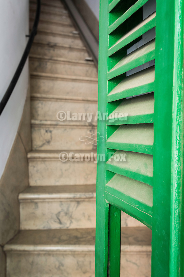 Narrow marble stairway to apartment over a shop in Llucmajor, Mallorca
