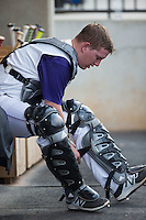 Winston-Salem Dash catcher Zack Collins (30) puts on his shin guards between innings of the game against the Potomac Nationals at BB&T Ballpark on July 15, 2016 in Winston-Salem, North Carolina.  (Brian Westerholt/Four Seam Images)