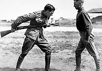 Training Camp Activities.  Bayonet fighting instruction by an English Sgt. Major, Camp Dick, Tex.  Ca.  1917-18.  (War Dept.)<br />Exact Date Shot Unknown<br />NARA FILE #:  165-WW-146B-16<br />WAR & CONFLICT BOOK #:  449