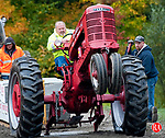HARWINTON, CT--- -100215JS06---Tom Bryda of Bristol, with his Farmall tractor, gets a full-pull on 9000 lbs. in the antique Tractor Pull's 6500 lb. class during the 159th annual Harwinton Fair Saturday at the Harwinton Fairground. The fair continues through today from 8:00 a.m .to 5:00 p.m.<br /> Jim Shannon Republican-American