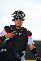 Jupiter Hammerheads catcher Rodrigo Vigil (15) poses for a photo as he walks to the dugout before a game against the Lakeland Flying Tigers on April 17, 2017 at Joker Marchant Stadium in Lakeland, Florida.  Lakeland defeated Jupiter 5-1.  (Mike Janes/Four Seam Images)