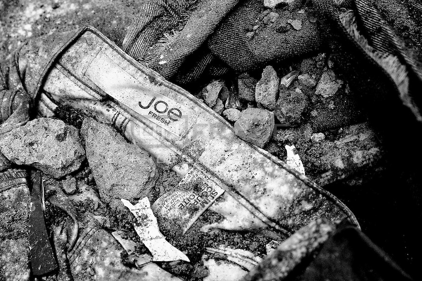 """Clothing bearing a label that reads """"Joe Fresh"""" from inside of the collapsed Rana Plaza. Savar,  Bangladesh"""