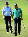 TAIPEI, TAIWAN - NOVEMBER 20:  Lu Chien Soon (R) of Taiwan and Roger Chapman of England walks on the 9th green during day three of the Fubon Senior Open at Miramar Golf & Country Club on November 20, 2011 in Taipei, Taiwan. Photo by Victor Fraile / The Power of Sport Images