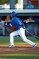 Matt Morales (21) of the Burlington Royals follows through on his swing against the Kingsport Mets at Burlington Athletic Stadium on July 27, 2018 in Burlington, North Carolina. The Mets defeated the Royals 8-0.  (Brian Westerholt/Four Seam Images)