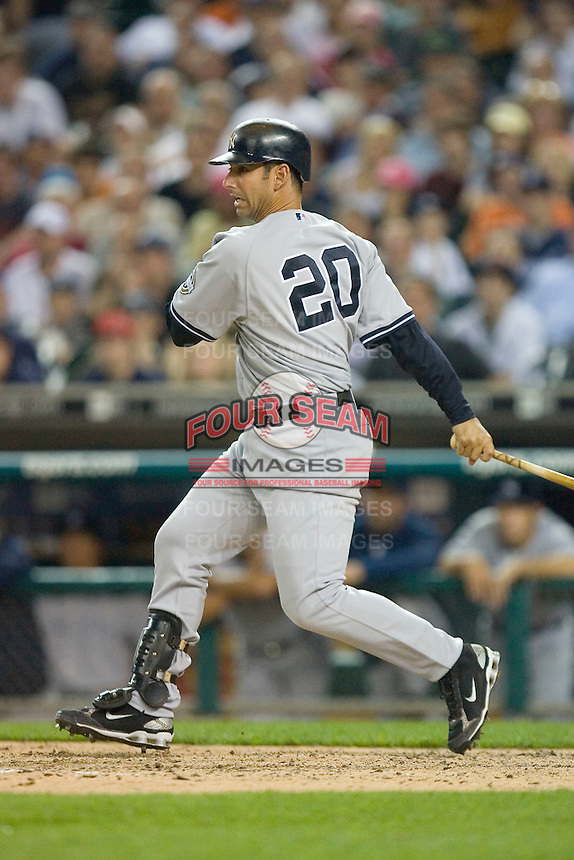 Jorge Posada #20 of the New York Yankees follows through on his swing against the Detroit Tigers at Comerica Park April 27, 2009 in Detroit, Michigan.  Photo by Brian Westerholt / Four Seam Images