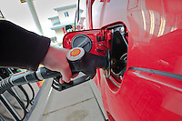 Filling a Toyota HiLux vehicle with diesel at a Shell fuel station.